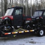 tracked side by sides on 24 ft tandem trailer